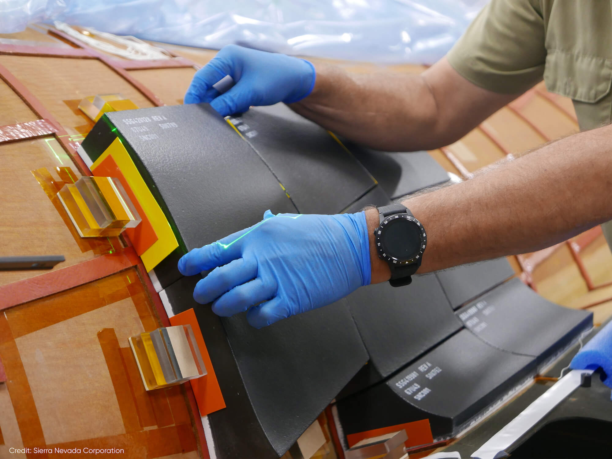 Bonding the Thermal Protection System tiles to the Dream Chaser structure