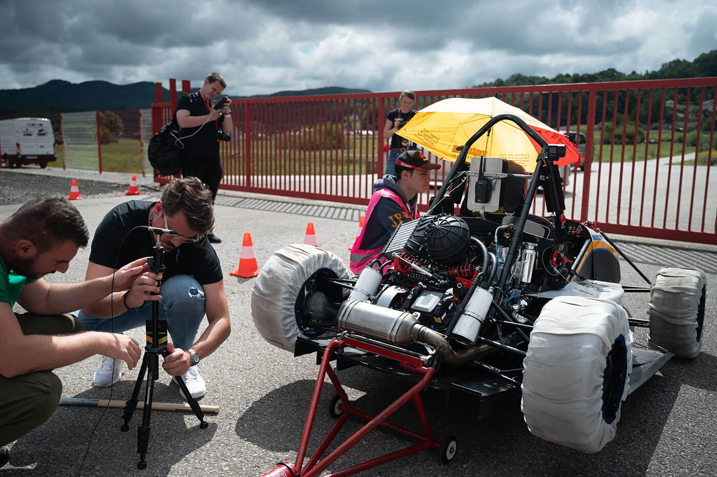 Dewesoft team fixing microphone to measure noise from the vehicle - formula race car