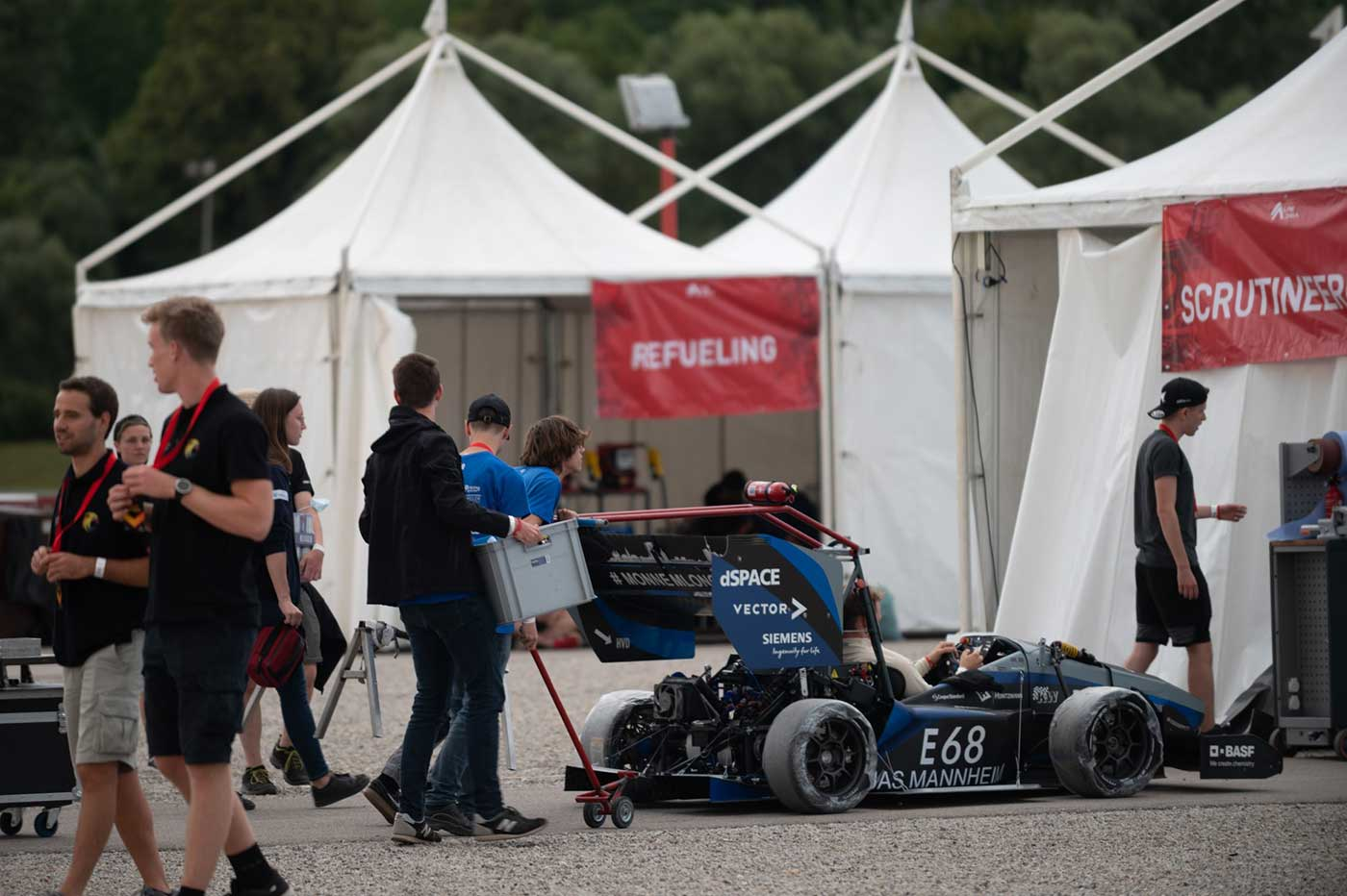 The Delta Racing Mannheim electric team getting their car ready for technical Inspection