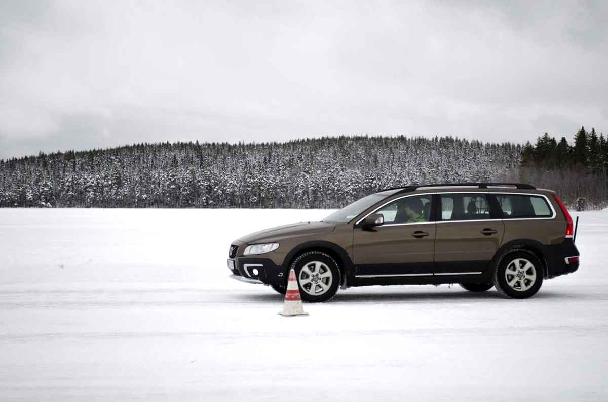 Car undergoing cold-weather tests on a frozen lake bed